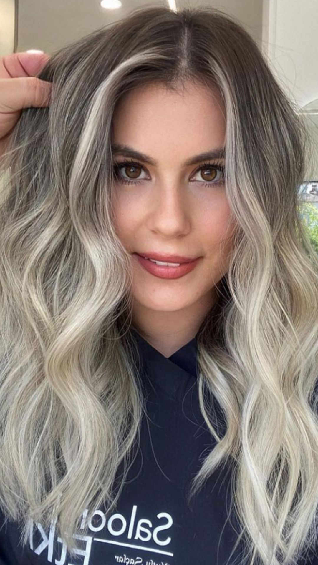 Charming brown hair with highlights is worth a try